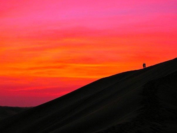 The vast desert beyond Abu Dhabi with beautiful orange hued sand dunes, UAE.