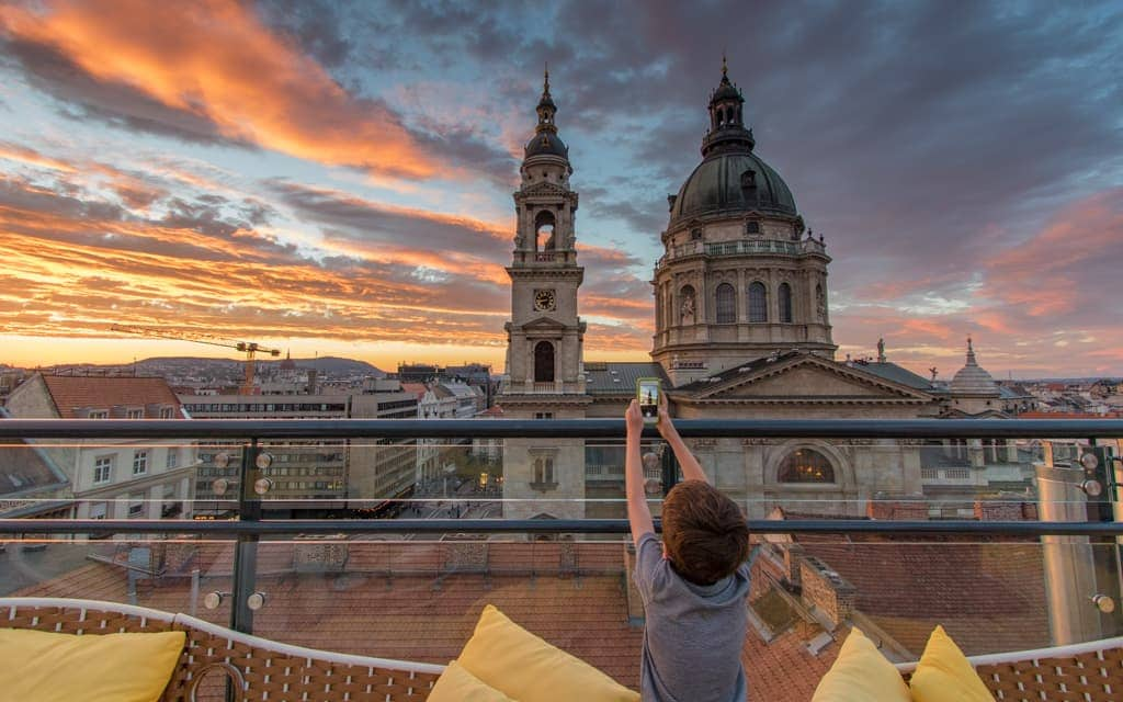 Kid-friendly Europe: Overlooking St. Stephen's Basilica from the rooftop patio of the Aria Hotel Budapest