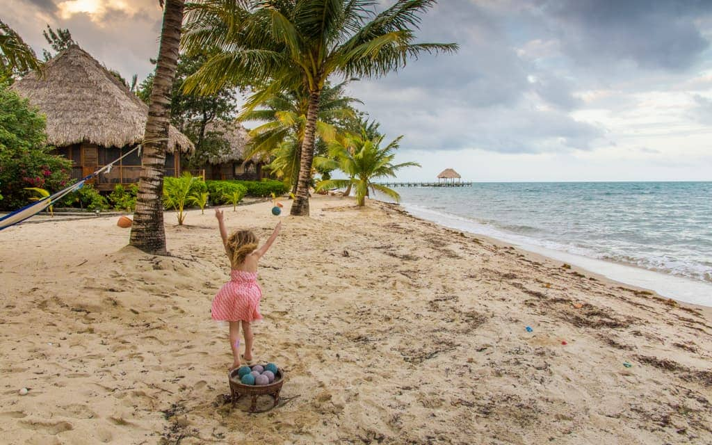 Travel with kids: Playing beach bocce in Belize (4 years old)