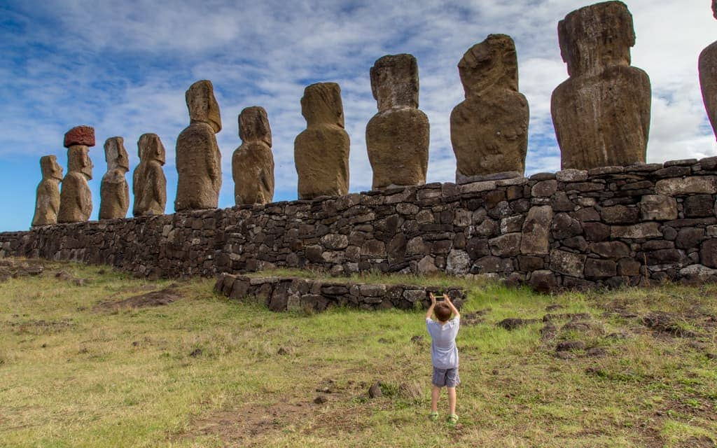Travel with Kids: Taking pictures at Tongariki on Easter Island (6 years old)