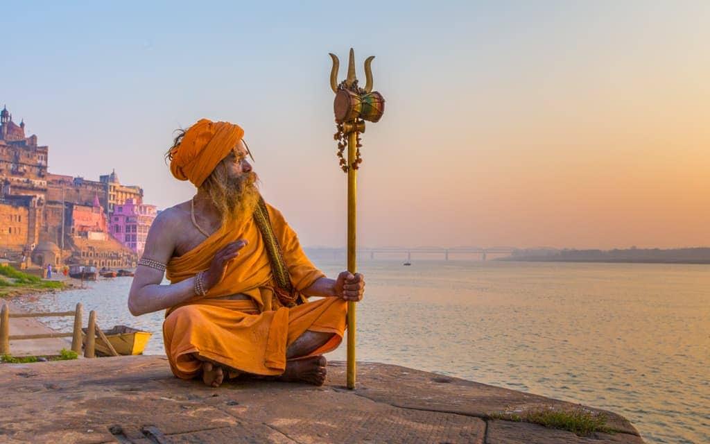 Travel inspiration: A Sadhu (holy man) at sunrise in Varanasi, India