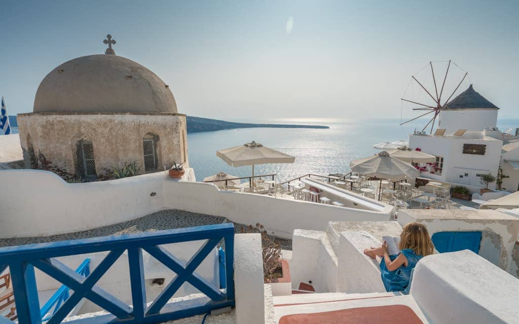 Best hotel views: We've stayed at three different places in and near Oia, all with amazing views. The view from our room at Golden Sunset Villas was just a little more interesting than the others - take the standard sunset view and add a church and a windmill!