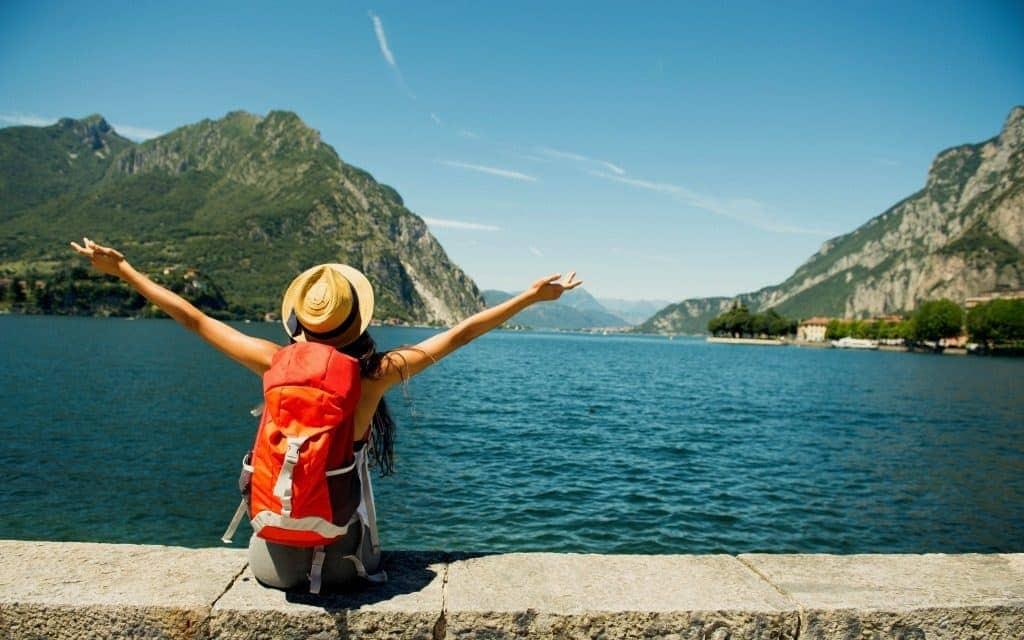 solo travel tips - female traveler overlooking lake