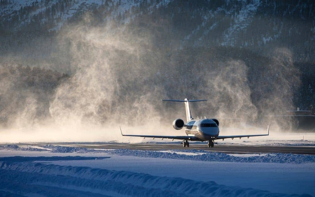 plane on a runway during winter