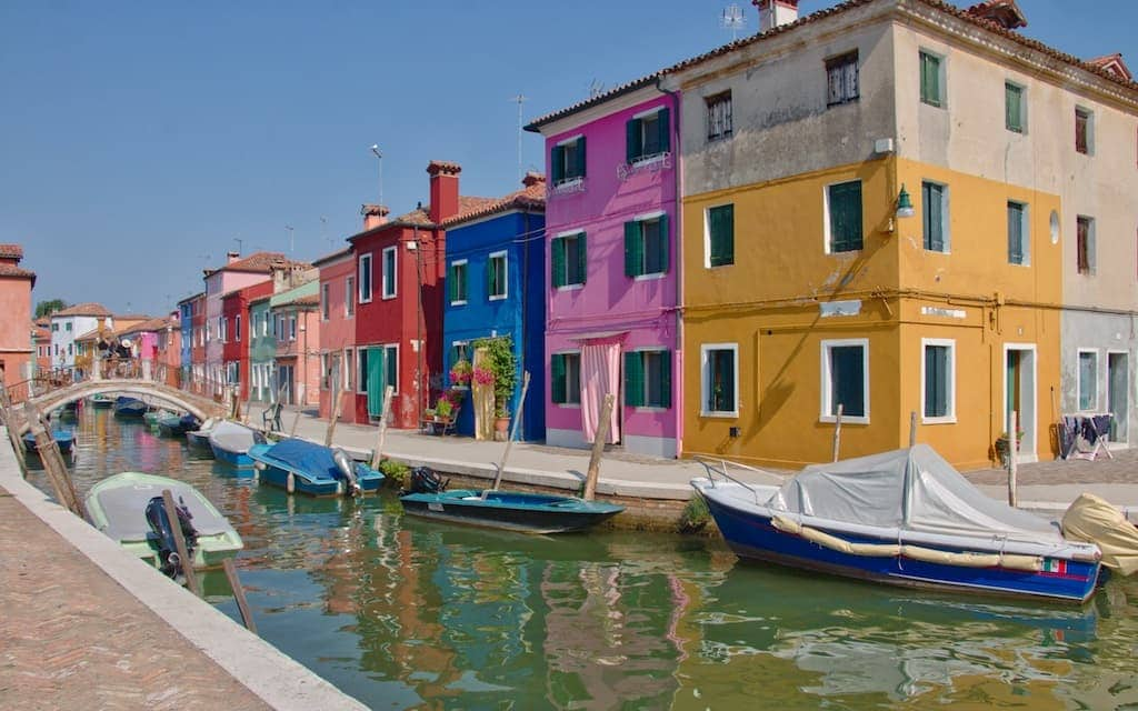 One of the most colorful places in the world isBurano Italy canal by MikesRoadTrip.com
