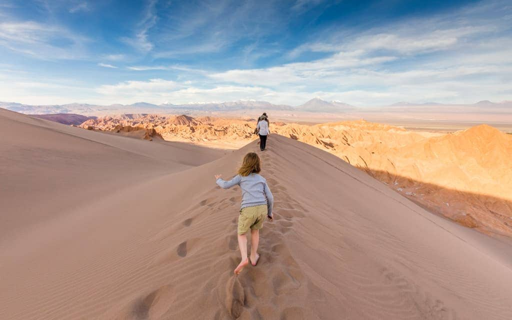 Family Travel 2018: Walking along a sand dune ridge in Chile's Atacama Desert