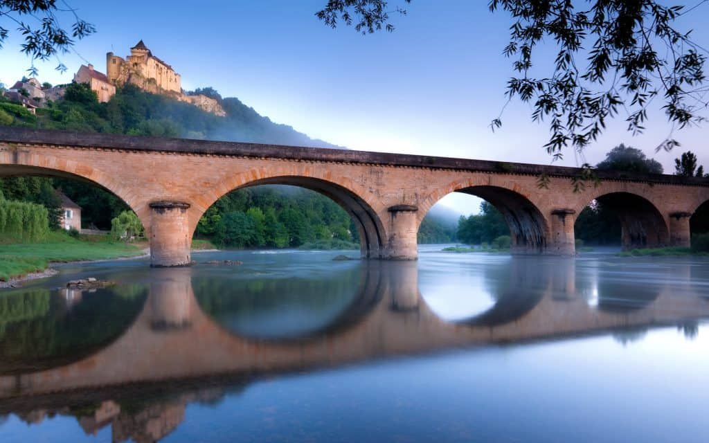 Sunrise at Chateau Castlenaud and the river Dordogne France