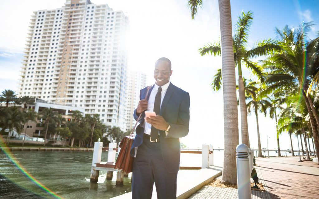 businessman texting in Miami