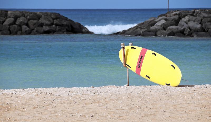 Lifeguard's rescue board on beach of lagoon at Ala Moana Beach Park in Honolulu