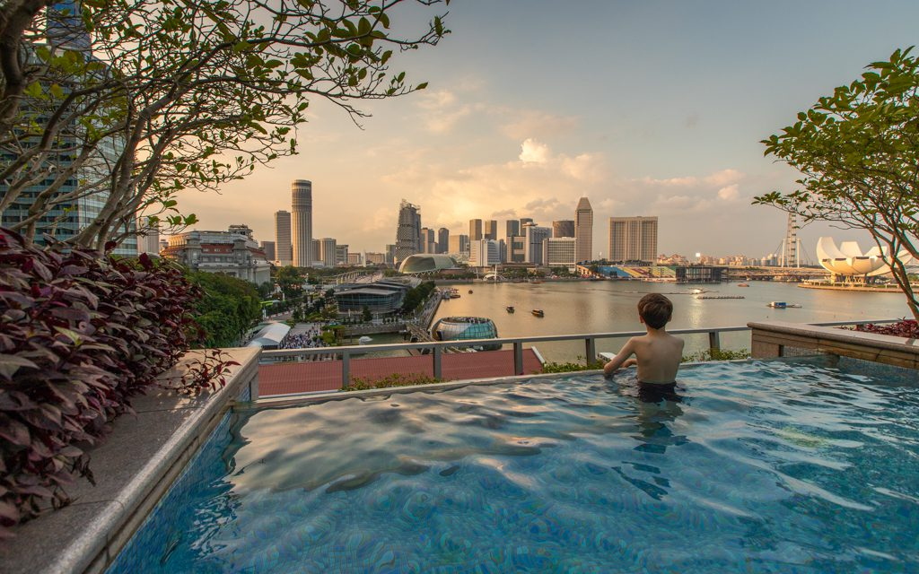 Best Big City Hotels - Sunset from the pool at Singapore's Fullerton Bay Hotel