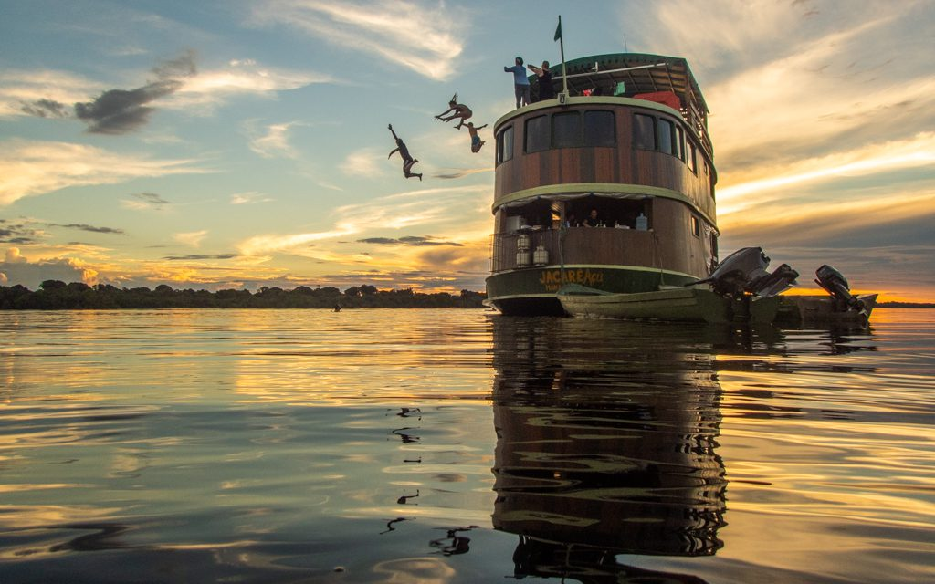 Where to travel in 2019 - Jumping from our boat into the Rio Negro