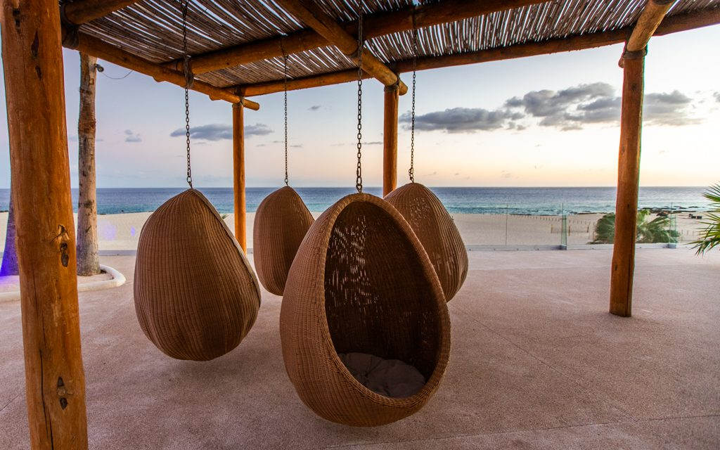 Los Cabos with Kids - Loved these hanging chairs overlooking the beach at Paradisus!