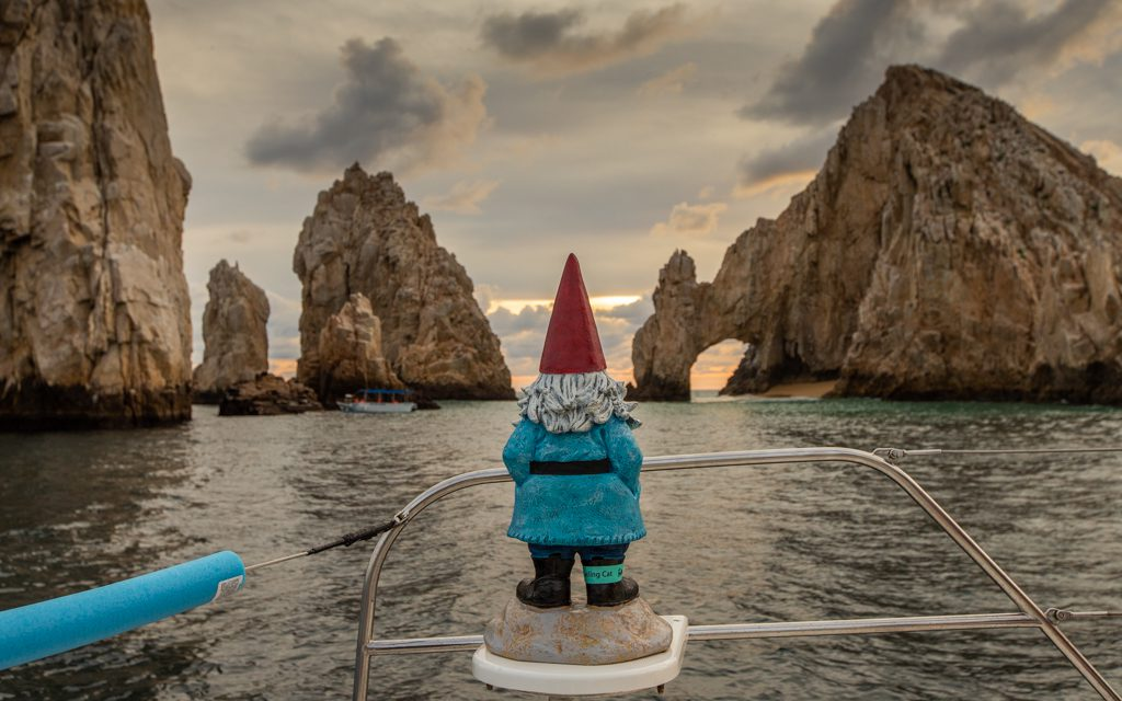 Los Cabos with Kids - The Roaming Gnome in front of the Los Cabos Land's End arch