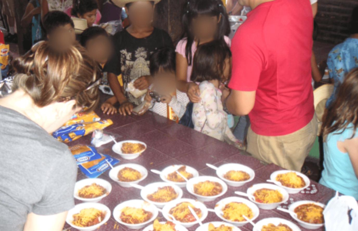Feeding kids at Orphanage