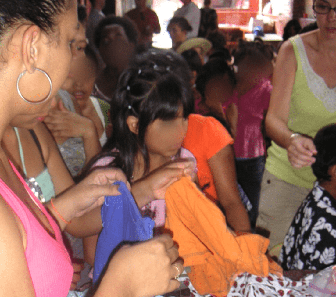 Passing out clothes at an orphanage