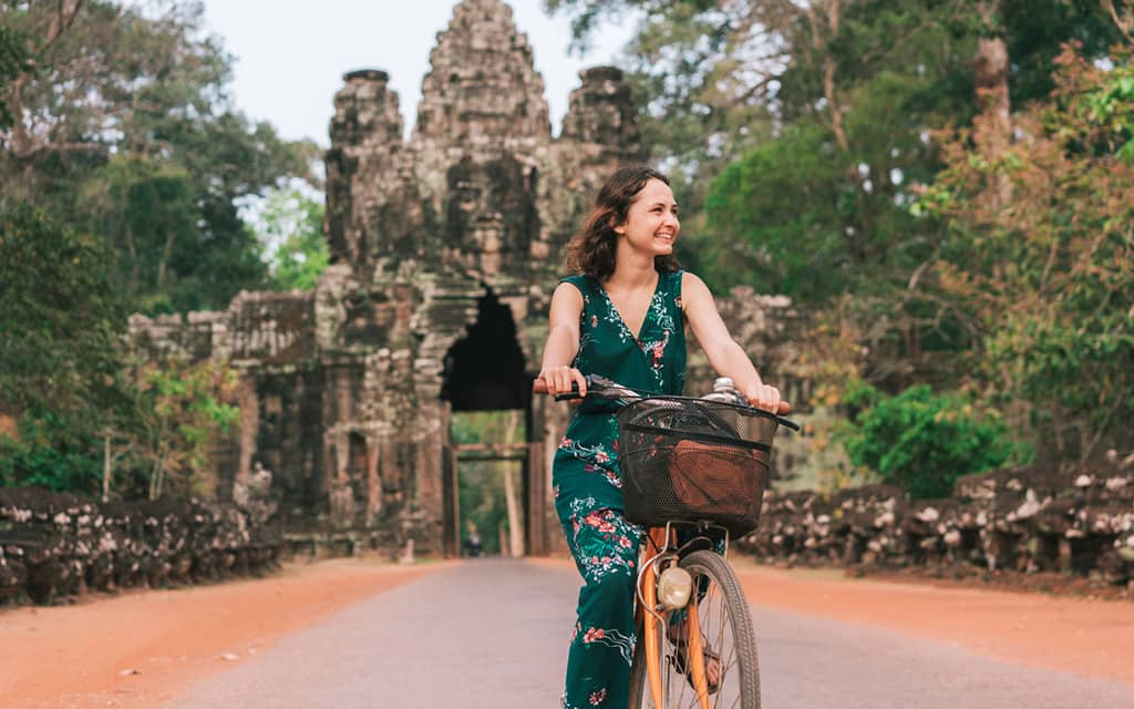 solo travel - woman on a bike in asia