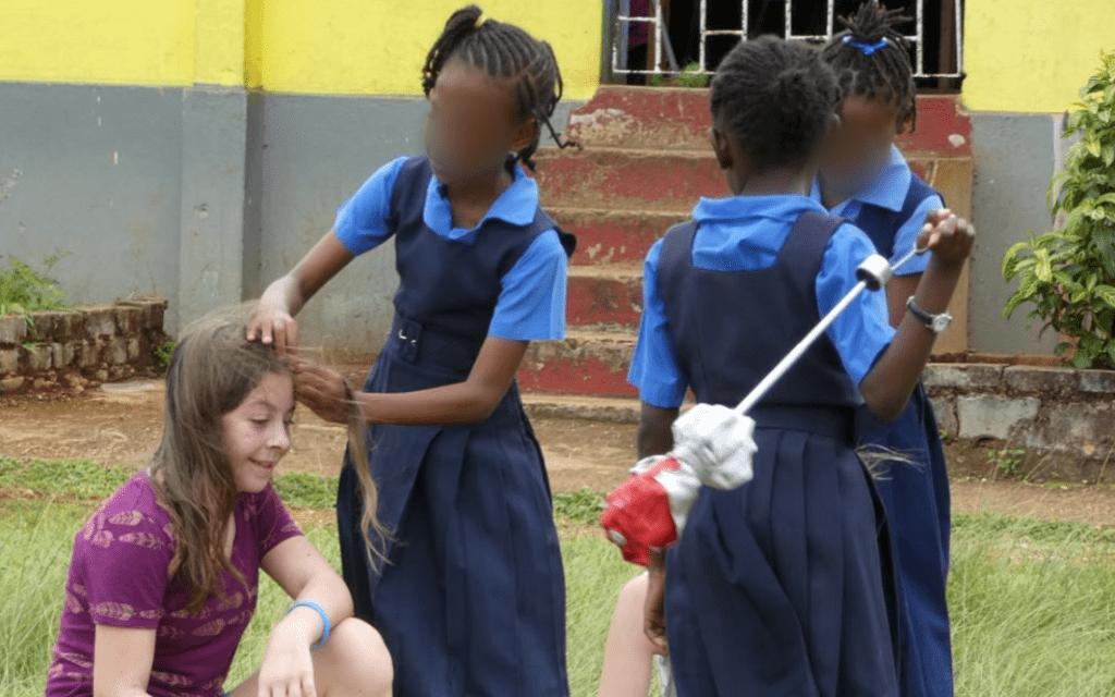 Eden's new friend braiding her hair