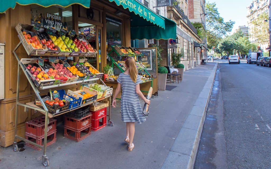 Paris on a Budget - Have the baguette, off to get some fruit. Picnics in Paris can't be beat!