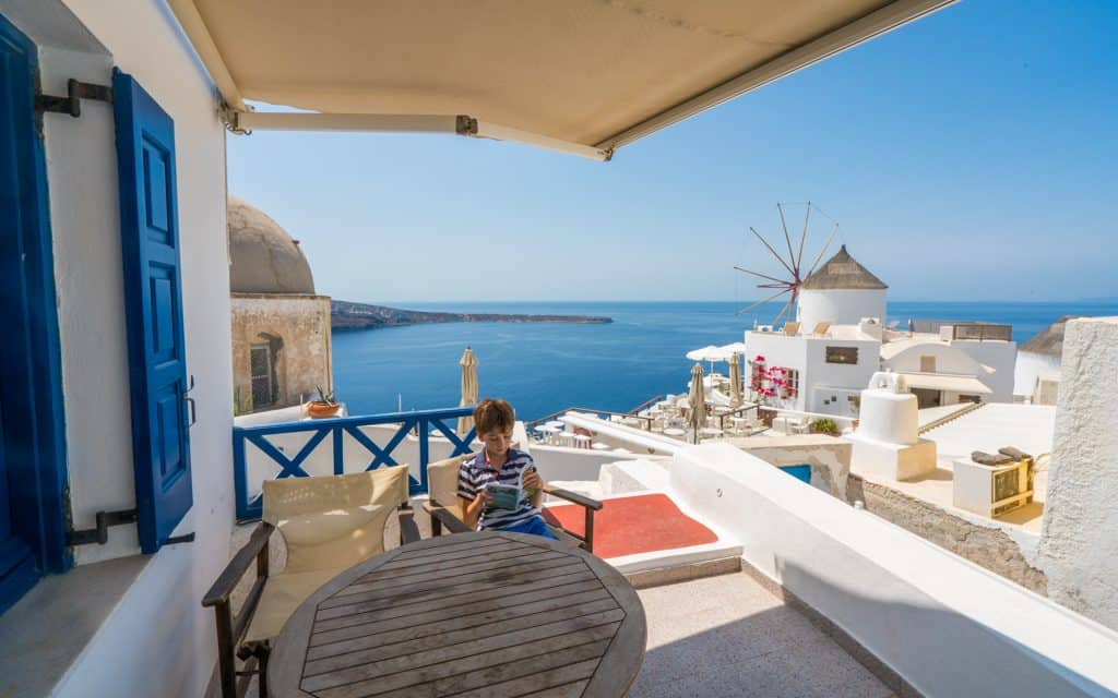 Family Travel Inspiration - Reading in Santorini, Greece