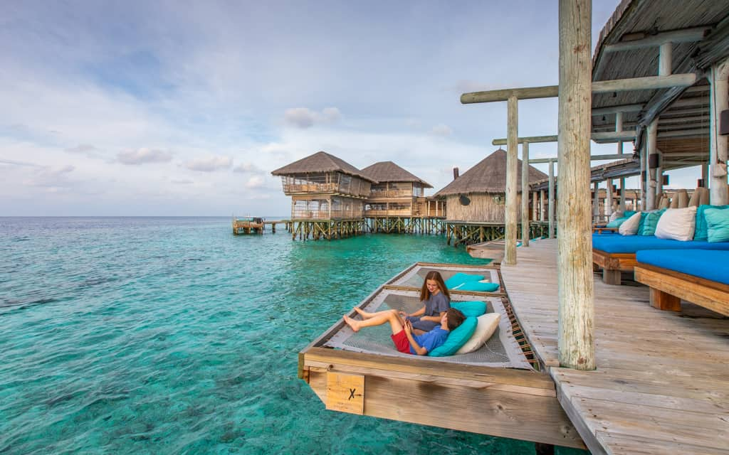 Family Travel Inspiration - Waiting for sunset in an overwater hammock in the Maldives