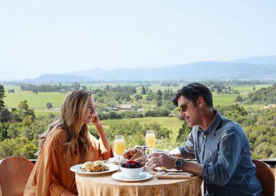 Couple Having Brunch At Restaurant Overlooking Napa Valley, Ca