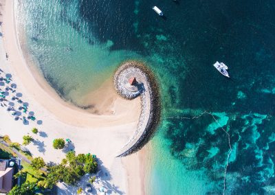 Bali coast with a figurative breakwater aerial view