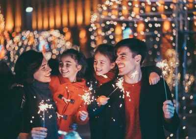 Happy family celebrating Christmas and New Year together